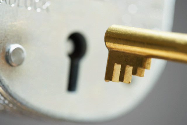 Skeleton Key Being Inserted into Lock --- Image by © moodboard/Corbis