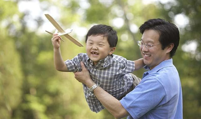 asian_father_and_son_playing_with_toy_airplane_BLD068847-e1364902429564